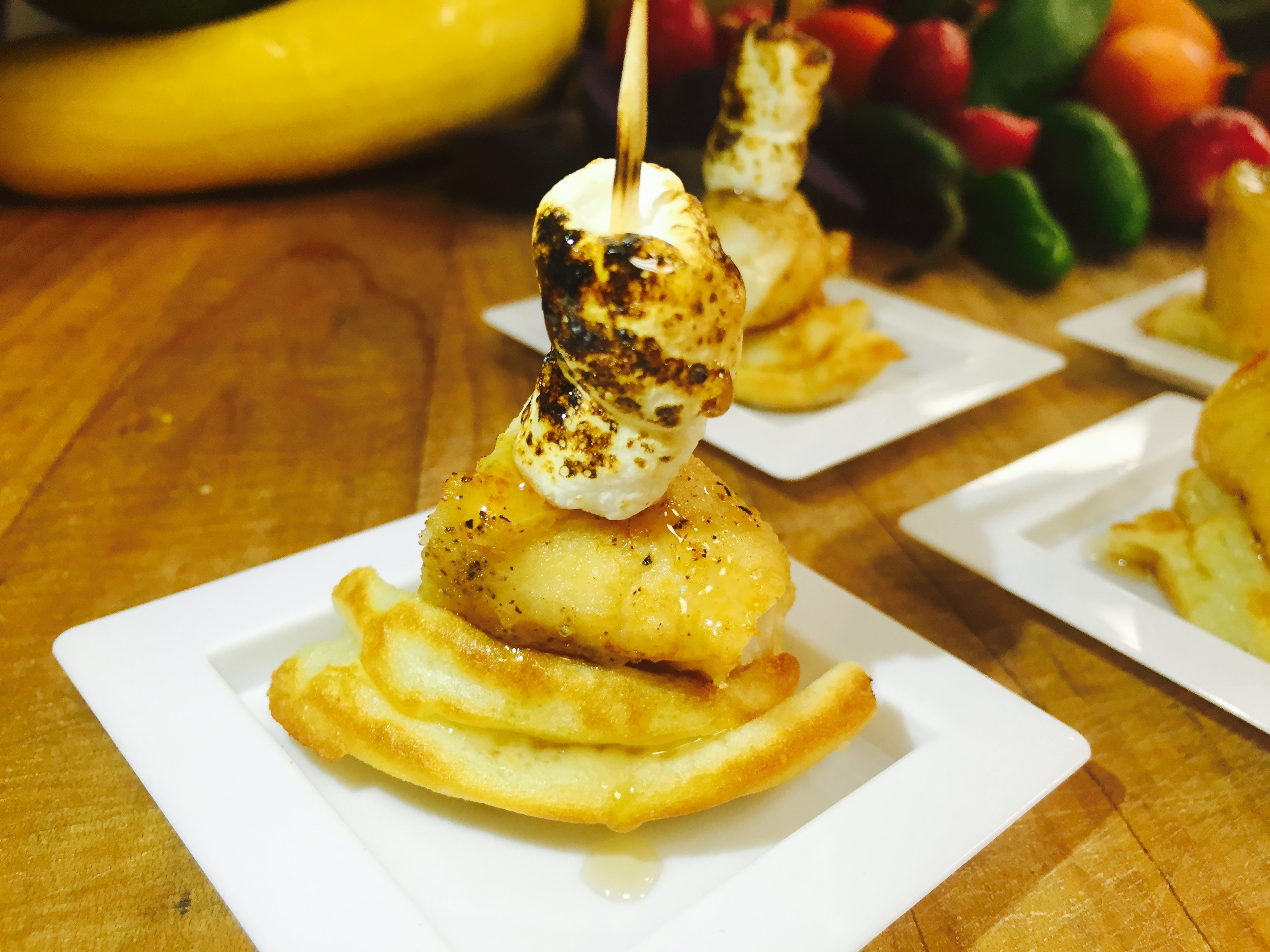 Southern Chicken and Waffles Topped with Fire Toasted Marshmallow and Drizzled with Maple Syrup