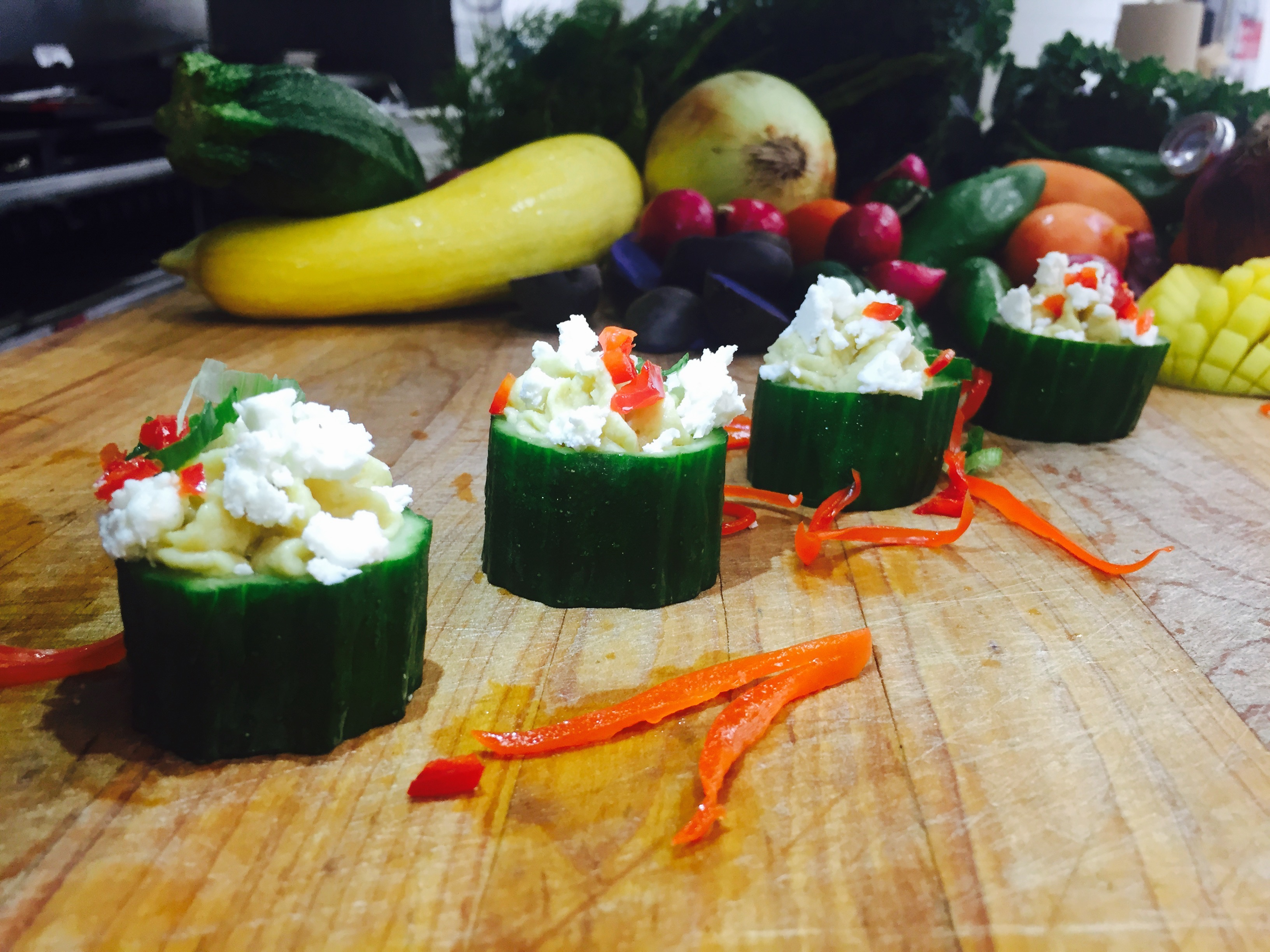 Lemony Hummus Topped with Feta Cheese in Cucumber Cups