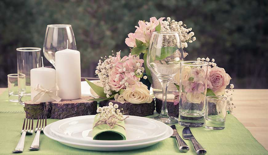 Table with flowers and cutlery